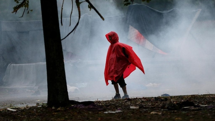 Migrant walks at the border between Croatia and Slovenia in Trnovec, Croatia, Monday, Oct. 19, 2015. Hundreds of migrants have spent the night in rain and cold at Croatia's border after being refused entry into Slovenia. (AP Photo/Petr David Josek)