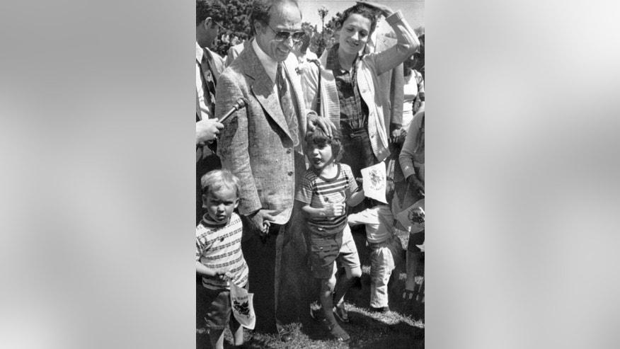 In this May 20, 1977, file photo, Canadian Prime Minister Pierre Trudeau and his wife, Margaret, accompanied by their children, Justin, center, Sacha, left, and Michael, right, stand together after a speech by the prime minister on Parliament Hill, in Ottawa, Canada. On Monday, Oct. 19, 2015, Canadian voters reclaimed their country's liberal identity sending Justin Trudeau to the prime minister's office and ending 10 years of conservative leadership under Stephen Harper. At 43, he becomes the second youngest prime minister in Canadian history. (AP Photo/File)
