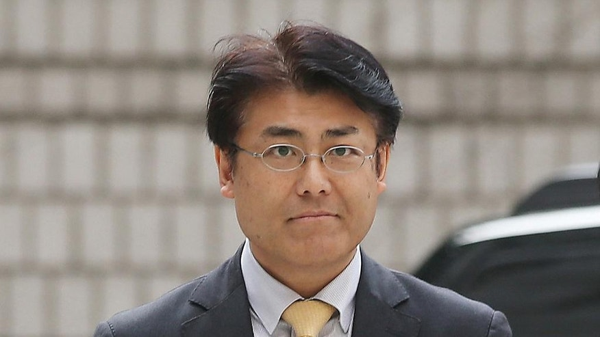 In this Oct. 19, 2015, photo, Tatsuya Kato, a former Seoul bureau chief of Japan's Sankei Shimbun, arrives at Seoul Central District Court in Seoul, South Korea. South Korean prosecutors have asked for an 18-month prison term for the Japanese journalist for allegedly defaming South Korea's president by reporting rumors that she was absent for seven hours during a ferry disaster last year because she was with a man, a court official said Tuesday, Oct. 20, 2015.(Shin Jun-hee/Yonhap via AP) KOREA OUT