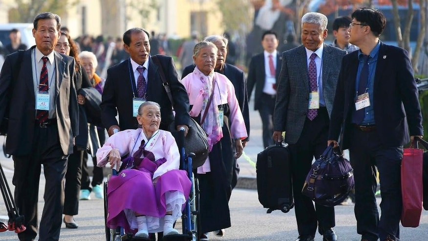 South Korean elderly people leave for North Korea to take part in family reunions with their North Korean family members at a hotel in Sokcho, South Korea, Tuesday, Oct. 20, 2015. About 640 South Koreans will be reunited with their North Korean relatives at the Diamond Mountain in North Korea from Oct. 20 to 26. (Kim Do-hoon/Yonhap via AP) KOREA OUT