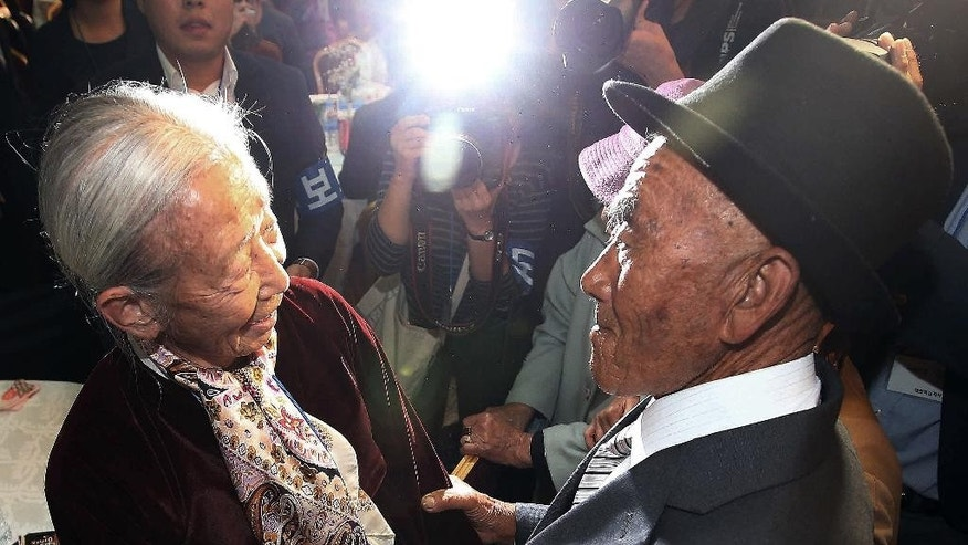 South Korean Lee Soon-kyu, 85, left, meets with her North Korean husband Oh Se In, 83, during the Separated Family Reunion Meeting at Diamond Mountain resort in North Korea, Tuesday, Oct. 20, 2015. Hundreds of elderly Koreans from divided North and South began three days of reunions Tuesday with loved ones many have had no contact with since the war between the countries more than 60 years ago.(Kim Do-hoon/Yonhap via AP) KOREA OUT
