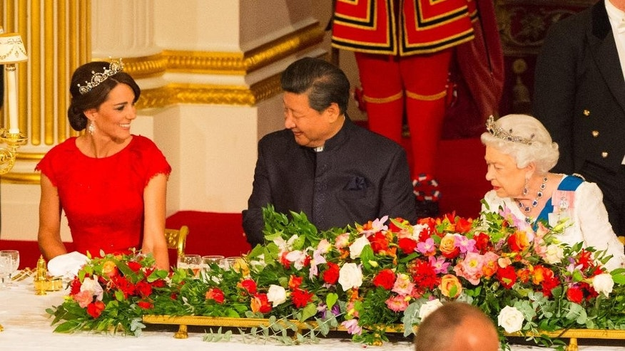 The Duchess of Cambridge, Chinese President Xi Jinping and Britain's Queen Elizabeth II attend a state banquet in the Ballroom at Buckingham Palace, London, on the first day of the state visit to the Britain, Tuesday Oct. 20, 2015. (Dominic Lipinski/Pool Photo via AP)