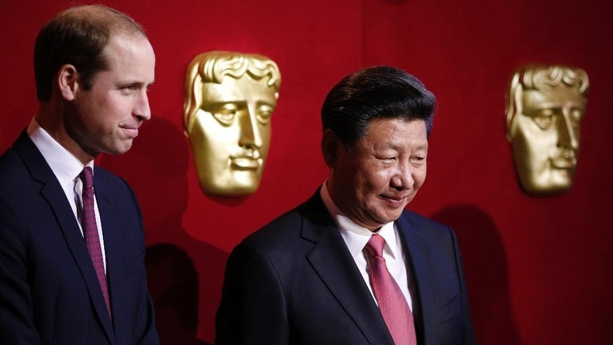 Chinese President Xi Jinping, right, and Britain's Prince William, Duke of Cambridge, attend a BAFTA presentation at Lancaster House in London, Wednesday, Oct. 21, 2015, during a UK-China Creative Collaborations Summit. Britain and China are set to seal business contracts worth billions on Wednesday, the second day of President Xi Jinping's four-day State Visit. (Adrian Dennis/Pool Photo via AP)
