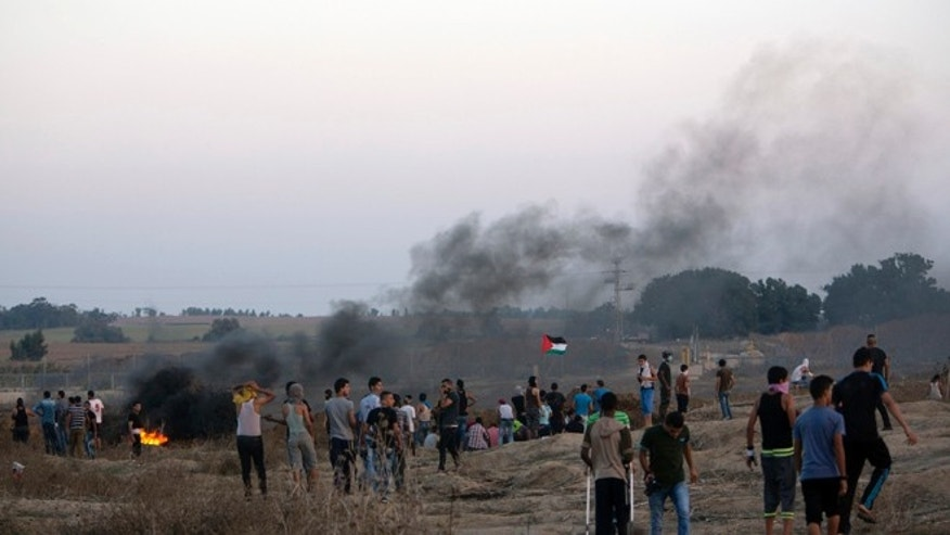 Oct. 15, 2015: Palestinian protesters clash with Israeli soldiers by the Israeli border with Gaza in Buriej, central Gaza Strip.