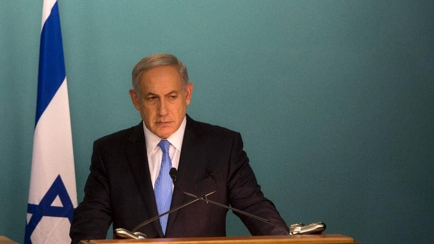 "Israeli Prime Minister Benjamin Netanyahu gives a press conference with United Nations Secretary-General Ban Ki-moon at the Prime Minister's office in Jerusalem, Tuesday, Oct. 20, 2015. Netanyahu said Palestinian President Mahmoud Abbas is ""fanning the flames"" of recent violence. Ban is in the region calling for calm in an attempt to curb weeks of violence that has killed 10 Israelis, 43 Palestinians and an Eritrean migrant worker.(AP Photo/Sebastian Scheiner)"