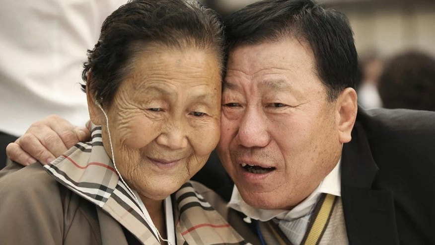 South Korean Park Mun-Su, 71, right, meets with his North Korean sister Pak Mun Kyong, 83, during the Separated Family Reunion Meeting at Diamond Mountain resort in North Korea, Wednesday, Oct. 21, 2015. Hundreds of elderly Koreans from divided North and South began three days of reunions Tuesday with loved ones many have had no contact with since the war between the two countries more than 60 years ago. (Kim Do-hoon/Yonhap via AP) KOREA OUT