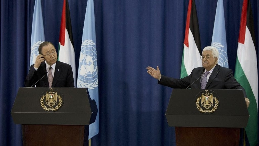 U.N. Secretary-General Ban Ki-moon, left, and Palestinian President Mahmoud Abbas hold a press conference in the West Bank city of Ramallah, Wednesday, Oct. 21, 2015. Ban called for calm during a surprise visit to Jerusalem on Tuesday ahead of meetings with Israeli and Palestinian leaders, in a high-profile gambit to bring an end to a monthlong wave of violence. (AP Photo/Majdi Mohammed)