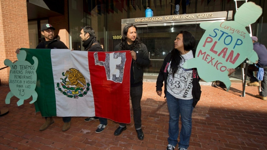 Oct. 20, 2015: Protestors, from left, Arnuldo Borja, SG Sarmiento, Jose Espada, and Madai Ledezma, gather during a rally outside the Organization of American States (OAS) in Washington to demand a follow-up to independent human rights report.