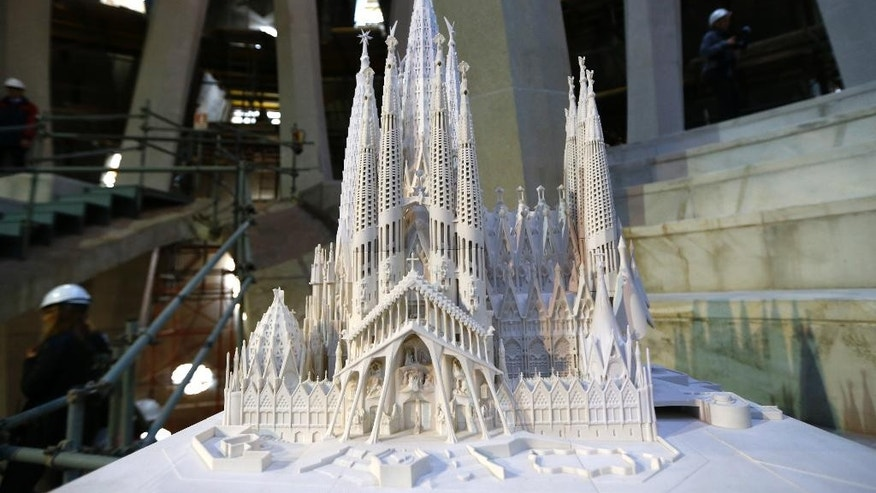 "A model of the Sagrada Familia Basilica designed by architect Antoni Gaudi is displayed at the Sagrada Familia Basilica in Barcelona, Spain, Wednesday, Oct. 21, 2015.  Barcelona's breathtaking La Sagrada Familia Basilica has begun its final phase of raising six immense towers. Presenting the project Thursday, chief architect Jordi Fauli said the central ""Tower of Jesus Christ,"" the tallest of the six, will rise 172.5 meters (566 feet) high, making it ""the tallest religious building in Europe."" (AP Photo/Manu Fernandez)"