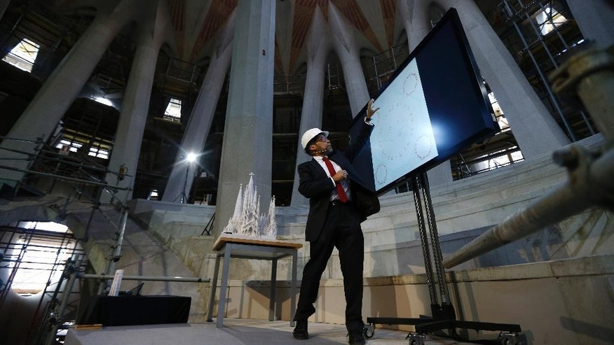 "Chief architect Jordi Fauli speaks during a news conference explaining the progress of the work at the Basilica Sagrada Familia in Barcelona, Spain, Wednesday, Oct. 21, 2015.  Barcelona's breathtaking La Sagrada Familia Basilica has begun its final phase of raising six immense towers that officials say will make it Europe's tallest religious building. Presenting the project Thursday, chief architect Jordi Fauli said the central ""Tower of Jesus Christ,"" the tallest of the six, will rise 172.5 meters (566 feet) high. (AP Photo/Manu Fernandez)"
