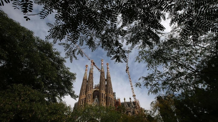 "A view of the Sagrada Familia Basilica, designed by architect Antoni Gaudi, in Barcelona, Spain, Wednesday, Oct. 21, 2015.  Barcelona's breathtaking La Sagrada Familia Basilica has begun its final phase of raising six immense towers. Presenting the project Thursday, chief architect Jordi Fauli said the central ""Tower of Jesus Christ,"" the tallest of the six, will rise 172.5 meters (566 feet) high, making it ""the tallest religious building in Europe."" (AP Photo/Manu Fernandez)"
