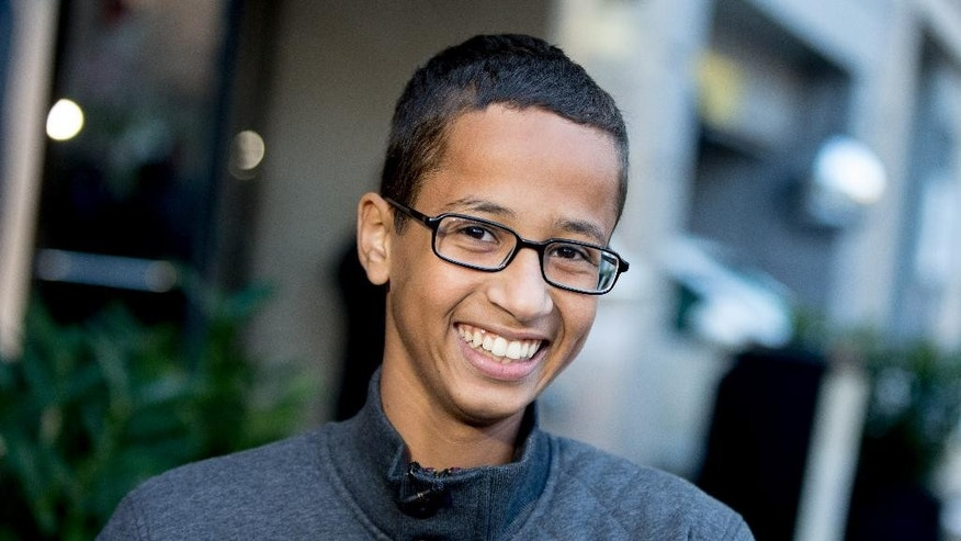 FILE - In this Monday, Oct. 19, 2015, file photo, Ahmed Mohamed, the 14-year-old who was arrested at MacArthur High School in Irving, Texas, after a homemade clock he brought to school was mistaken for a bomb, speaks during an interview with the Associated Press, in Washington. Ahmed Mohamed will soon be moving with his family to Qatar to attend school thanks to the Qatar Foundation for Education, Science and Community Development.  (AP Photo/Andrew Harnik, File)
