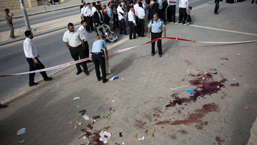 Oct. 22, 2015: Israeli police officers inspect the scene of a stabbing attack in Beit Shemesh, central Israel.