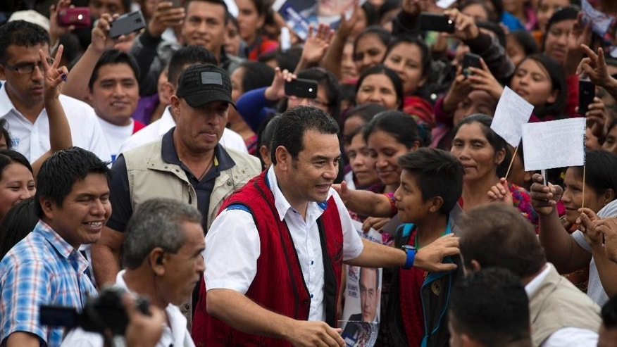 In this Oct. 17, 2015 photo, presidential candidate Jimmy Morales, a comedian from the National Front of Convergence party, arrives for a campaign rally in Chichicastenango, Guatemala. The Oct. 25 presidential runoff pits this comedian against Sandra Torres, a businesswoman and former first lady. (AP Photo/Moises Castillo)