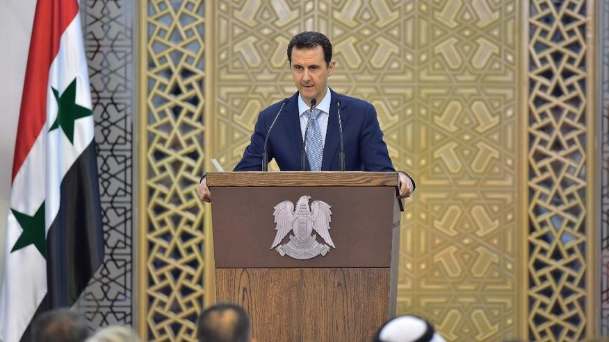 FILE - In this Sunday, July 26, 2015, file photo released by the Syrian official news agency SANA, Syrian President Bashar Assad delivers a speech in Damascus, Syria. Russia's military intervention in Syria is increasingly bolstering the sense that Bashar Assad may survive the war, and his surprise visit to Moscow the first time he's left the country in nearly five years underscores just how emboldened the Syrian leader has become. (SANA via AP, File)