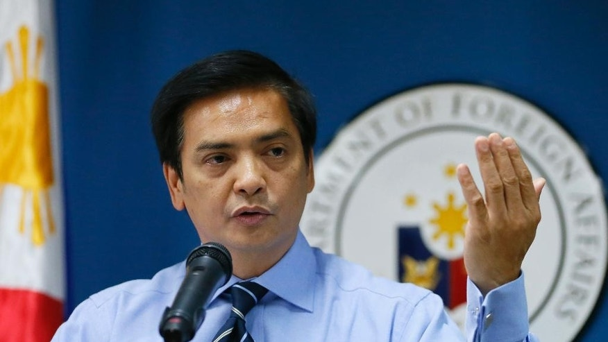 Charles Jose, assistant secretary and spokesman of the Department of Foreign Affairs, gestures during a news conference on Wednesday's killing of a couple of Chinese diplomats and the wounding of a consul-general by a fellow Chinese in Cebu city, central Philippines, at suburban Pasay city, south of Manila, Thursday, Oct. 22, 2015. Jose said, the suspect, who is the spouse of a Chinese diplomat, claimed diplomatic immunity and a team of Chinese officials will arrive to take custody of the couple for prosecution in China. (AP Photo/Bullit Marquez)