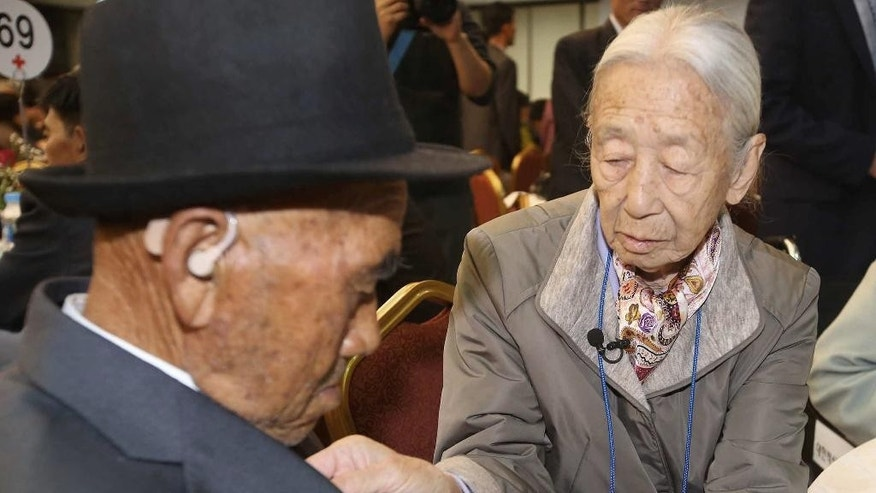 South Korean Lee Soon-kyu, 85, right, adjusts the necktie of her North Korean husband Oh In Se, 83, after the Separated Family Reunion Meeting at the Diamond Mountain resort in North Korea, Thursday, Oct. 22, 2015. About 390 South Koreans are temporally in the mountain resort for three days of reunions with loved ones many have had no contact with since war divided the North and South more than 60 years ago. (Kim Do-hoon/Yonhap via AP) KOREA OUT