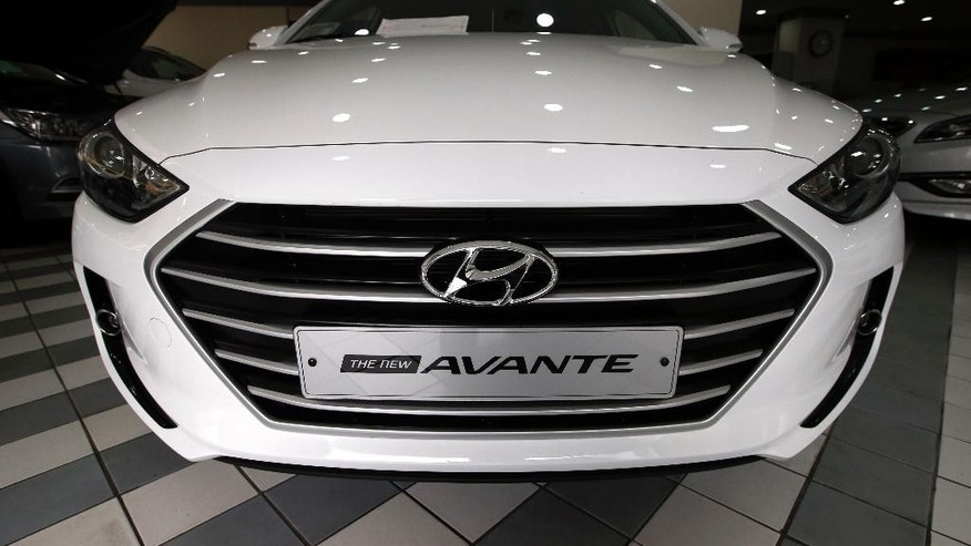Hyundai Motor's sedan Avante is displayed at its showroom in Seoul, South Korea, Thursday, Oct. 22, 2015. Hyundai Motor Co. reported Thursday its lowest quarterly earnings in more than five years after losing ground to local brands in China and underestimating strong demand for SUVs. (AP Photo/Lee Jin-man)