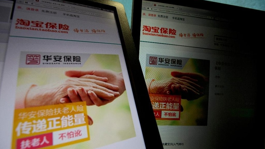 An e-commerce website by Alibaba and Hua'an insurance, also known as Sinosafe Insurance, selling an insurance product to protect good Samaritans from being scammed by elderly people they help is displayed on computer screens in Beijing, Thursday Oct. 22, 2015. Concern has grown in recent years with scams in which elderly people are found to have turned against their helpers. Some have been caught on video purposely falling next to cars to rip off the motorists. (AP Photo/Ng Han Guan)