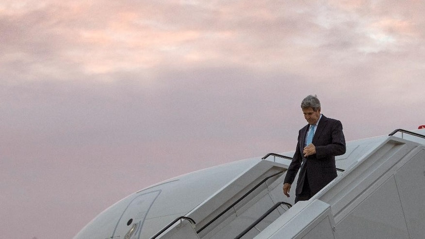 U.S. Secretary of State John Kerry disembarks his plane upon arrival at Tegel airport in Berlin, Germany Thursday, Oct. 22, 2015. Kerry flew to Berlin Thursday for talks with Israeli Prime Minister Benjamin Netanyahu that he hopes will help ease spiraling tensions and violence with the Palestinians. (Carlo Allegri/Pool Photo via AP)