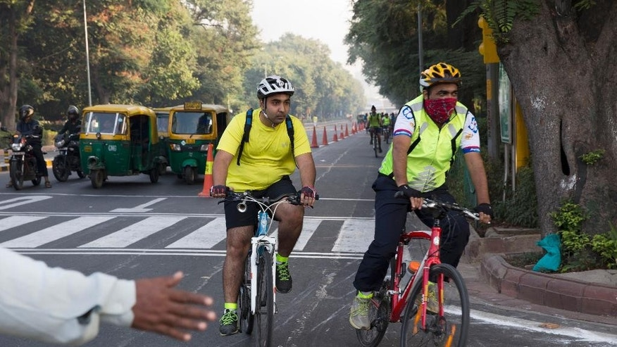 Indians participate in a cycle rally during a car-free day covered only a six-kilometer (4-mile) stretch in New Delhi, India, Thursday, Oct. 22, 2015. The world's most polluted capital, New Delhi, closed a major stretch of road to private cars for a few hours, hoping to give its citizens a brief breath of fresh air by observing a car-free day. (AP Photo/Tsering Topgyal)
