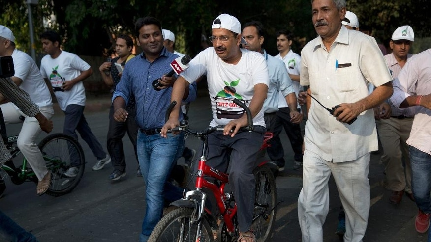 Delhi Chief Minister Arvind Kejriwal, center, takes part in a cycle rally during a car-free day covered only a six-kilometer (4-mile) stretch in New Delhi, India, Thursday, Oct. 22, 2015. The world's most polluted capital, New Delhi, closed a major stretch of road to private cars for a few hours, hoping to give its citizens a brief breath of fresh air by observing a car-free day. (AP Photo/Tsering Topgyal)