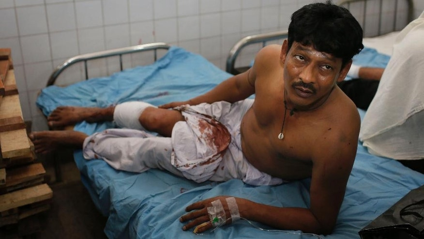 Motiur Rahman, 48, who sustained injuries after an explosion, is treated at a hospital in Dhaka, Bangladesh, Saturday, Oct. 24, 2015. Unidentified attackers threw home-made bombs early Saturday at thousands of Shiite Muslims gathered for a traditional procession to a shrine in Bangladesh's capital. (AP Photo/A.M. Ahad)