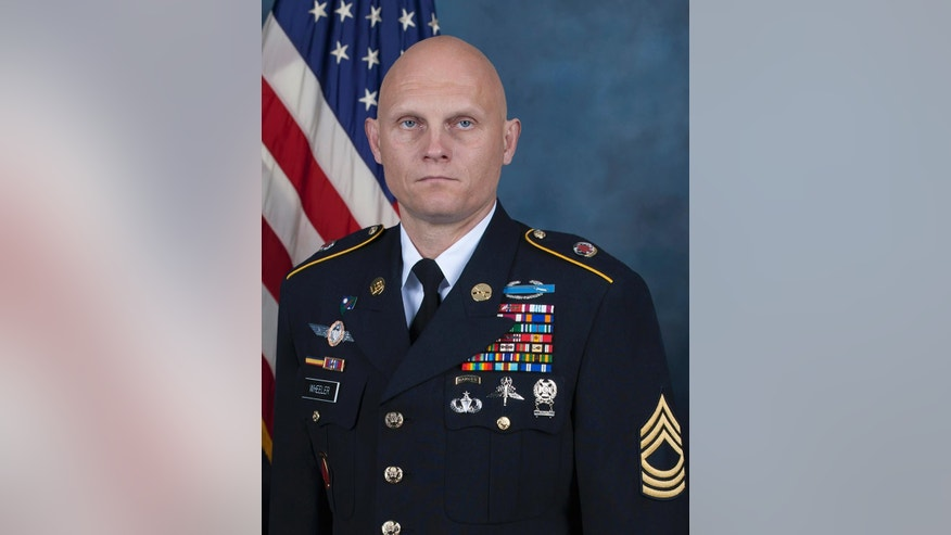 This photo provided by the U.S. Army shows Master Sgt. Joshua Wheeler. Wheeler. A spokesman for the U.S.-led coalition in Iraq has identified the commando killed in a raid against the Islamic State group in northern Iraq as Master Sgt. Joshua Wheeler.  (US Army via AP)
