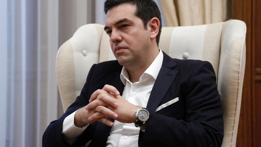 Greek Prime Minister Alexis Tsipras listens to French President Francois Hollande during their meeting at Maximos Mansion in Athens, Friday, Oct. 23, 2015. Hollande called Thursday for talks on relieving Greece's crushing debt load and investment, in combination with the harsh austerity measures international creditors have demanded over the past five years in return for vital rescue loans. (Yannis Kolesidis/Pool photo via AP)