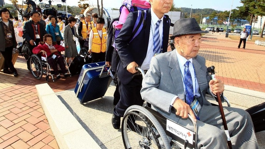 South Korean elderly people leave for North Korea to take part in family reunions with their North Korean family members at Inter Korean transit office in Goseong, South Korea, Saturday, Oct. 24, 2015. Hundreds of South Koreans have crossed the border to North Korea for the second and final round of reunions of families separated by the 1950-53 Korean War. (Lee Jong-gun/Yonhap via AP) KOREA OUT