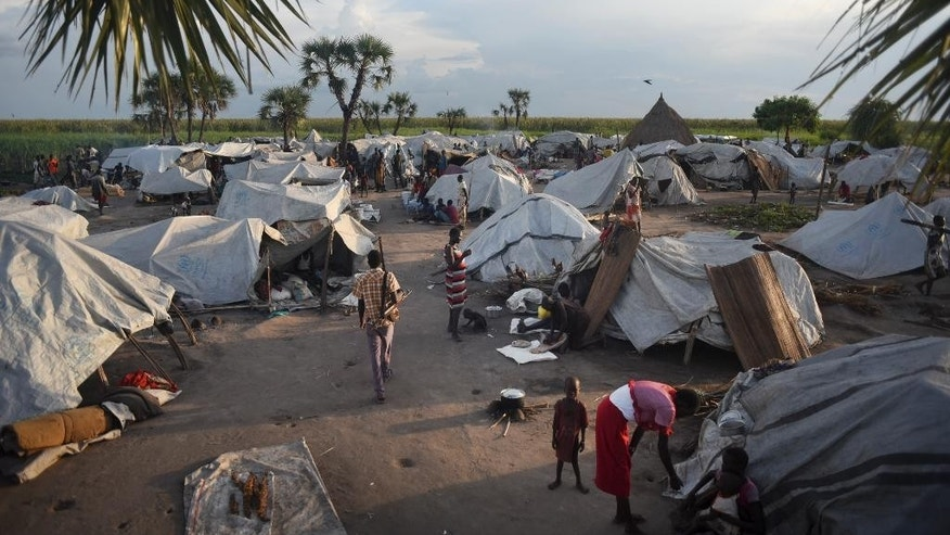 In this photo taken Tuesday, Oct. 13, 2015, displaced people live in a camp of makeshift tents at Kok island, where around 900 people have taken shelter from fighting, in Unity State, South Sudan. Kok Island in Unity State has become a place of misery, with hundreds of war-weary people reaching there to seek shelter from the violence, just some of the more than 2 million displaced by South Sudan's civil war, which continues despite a peace accord signed in August. (AP Photo/Jason Patinkin)
