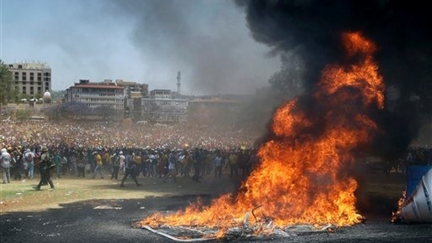Thousands of South African university students protesting planned tuition hikes Friday. (AP Photo/Themba Hadebe)
