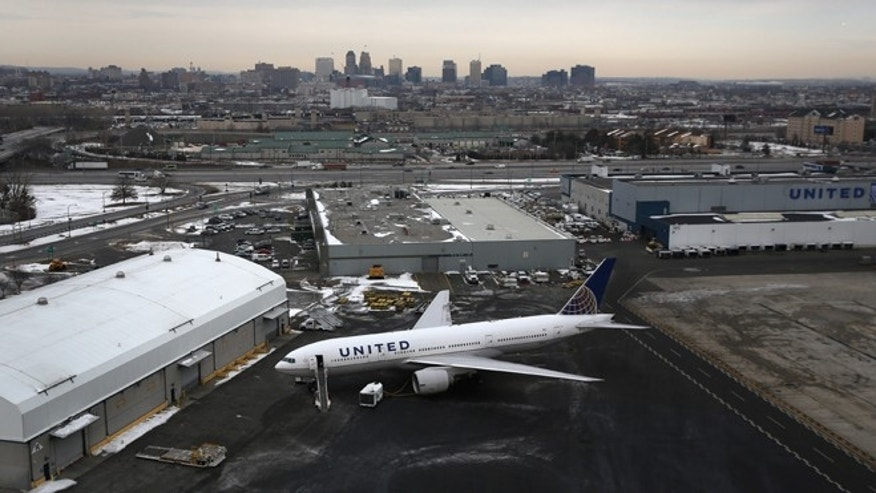 "NEWARK, NJ - JANUARY 31:  A United Airlines jet sits parked at Newark Liberty International Airport as seen from the window of a Customs and Border Protection (CBP), Blackhawk helicopter ahead of Super Bowl XLVIII on January 31, 2014 in Newark, New Jersey. Helicopters flown by ""air interdiction agents"" from the CBP's Office of Air and Marine (OAM), are providing air support for Super Bowl XLVIII between the Denver Broncos and the Seattle Seahawks this Sunday.  (Photo by John Moore/Getty Images)"