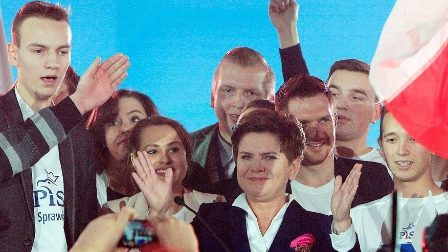 Beata Szydlo, candidate for prime minister of the conservative opposition Law and Justice party in Sunday's general elections after  celebrates with supporters at a party convention that wraps up months of campaigning in Warsaw, Poland, on Thursday, Oct. 22, 2015. Opinion polls show Law and Justice slightly ahead of the ruling pro-business Civic Platform party. (AP Photo/Czarek Sokolowski)