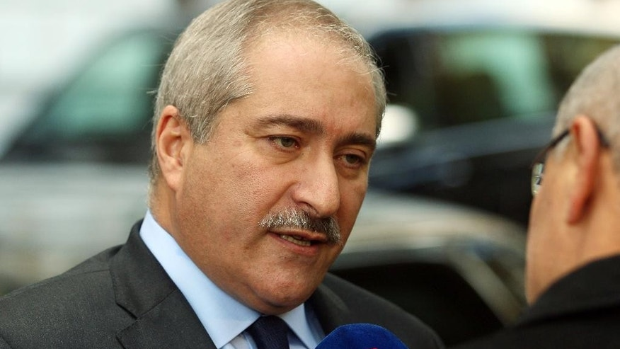 Jordanian Foreign Minister Nasser Judeh talkjs to journalists in front of a hotel after meetings in Vienna, Austria, Friday, Oct. 23, 2015. (AP Photo/Ronald Zak)
