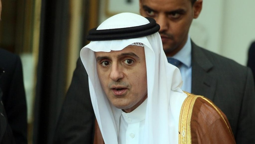 Saudi Arabia's Foreign Minister Adel al-Jubeir is leaving a hotel after a meeting in Vienna, Austria, Friday, Oct. 23, 2015. U.S. Secretary of State John Kerry opened talks in Vienna on Friday with his Russian, Saudi and Turkish counterparts aimed at reviving a moribund effort to end Syria's civil war. (AP Photo/Ronald Zak)