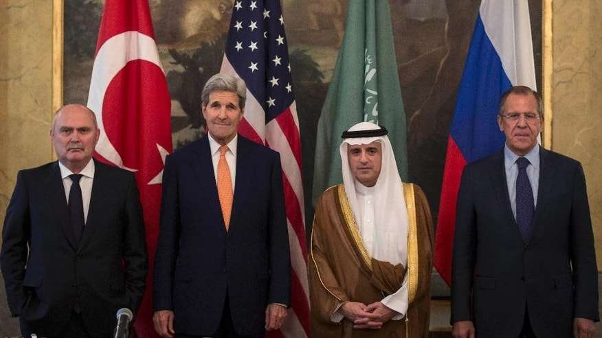 From left, Turkey's Minister of Foreign Affairs, Feridun Sinirlioglu,  U.S. Secretary of State John Kerry,  Saudi Arabia's  Minister of Foreign Affairs Arabia Adel al-Jubeir and Russia's Foreign Minister Sergey Lavrov pose for a photo, during a meeting in Vienna, Friday,  Oct. 23, 2015. Kerry and his Russian, Saudi and Turkish counterparts met in Vienna on Friday, seeking to revive a moribund effort to end Syria's civil war. Carlo Allegri/Pool Photo via AP)
