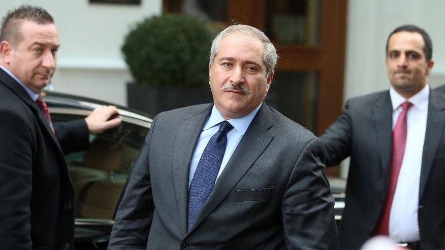Jordanian Foreign Minister Nasser Judeh is leaving a hotel after meetings in Vienna, Austria, Friday, Oct. 23, 2015. (AP Photo/Ronald Zak)