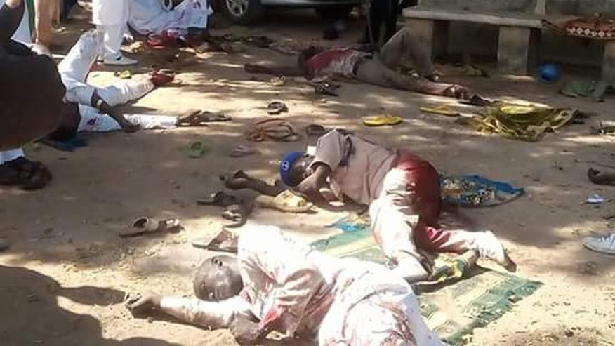 Bodies lies on the ground following a bomb explosion in Yola, Nigeria, Friday, Oct. 23, 2015. Two suicide bombers struck at city mosques in northeast Nigeria on Friday, killing over 40 people and wounding more than 100, an official and witnesses said. (AP Photo/Ibrahim Abdulaziz)