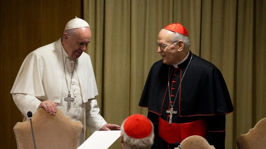 Pope Francis talks with Cardinal Peter Erdo as he  arrives for the morning session of the last day of the Synod of bishops, at the Vatican, Saturday, Oct. 24, 2015. (AP Photo/Alessandra Tarantino)