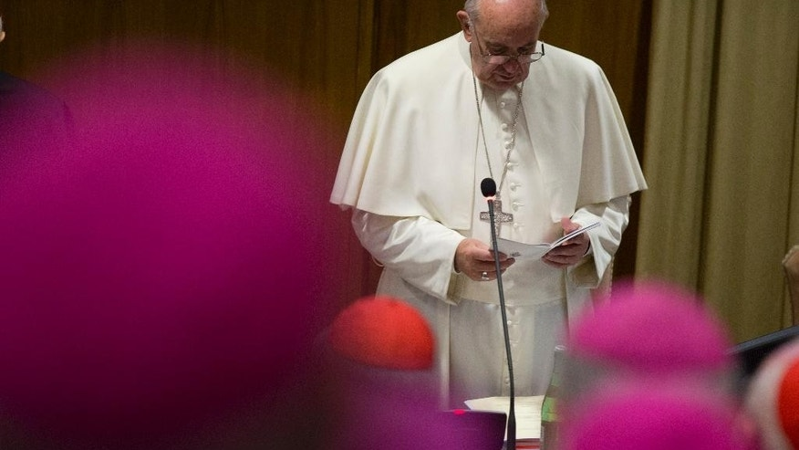 Pope Francis prays as he opens  morning session of the last day of the Synod of bishops, at the Vatican, Saturday, Oct. 24, 2015. (AP Photo/Alessandra Tarantino)