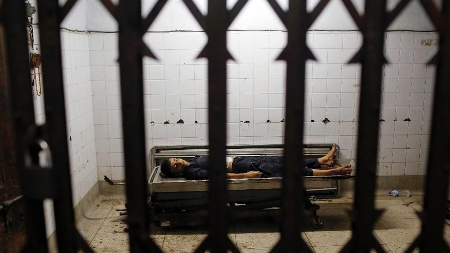 The body of Sazzad Hossain Shanju, 15, who was killed in a bomb explosion during a religious ceremony on the eve of Ashoura, lies in a hospital in Dhaka, Bangladesh, Saturday, Oct. 24, 2015. Shanju was killed when unidentified attackers threw home-made bombs early Saturday at thousands of Shiite Muslims gathered for a traditional procession in Bangladesh's capital. At least five bombs were thrown, police said. Three exploded and two were recovered. (AP Photo/A.M. Ahad)