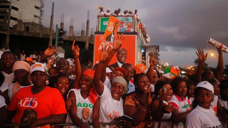 Supporter of  Ivory Coast incumbent President Alassane Ouattara react during his election rally  in Abidjan, Ivory Coast, Friday, Oct. 23, 2015.  Ivory Coast's president is widely expected to win a second term as the West African nation votes Sunday, five years after a disputed poll that spilled over into the worst violence the country has experienced since independence.  (AP Photo/Schalk van Zuydam)