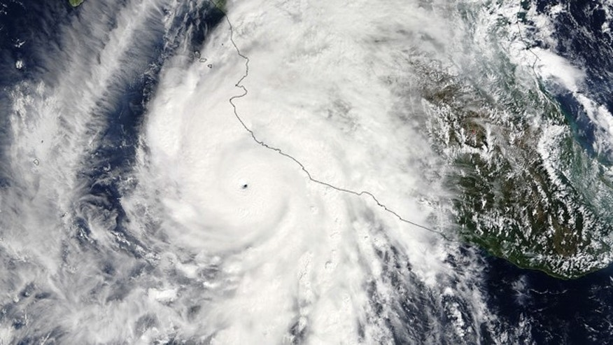 This satellite image taken at 1:30 p.m. EDT on Friday, Oct. 23, 2015, and released by NASA, shows the eastern quadrant and pinhole eye of Hurricane Patricia moving towards southwestern Mexico. The Category 5 storm is strongest ever in the Western Hemisphere, according to forecasters. (Goddard MODIS Rapid Response Team/NASA via AP)