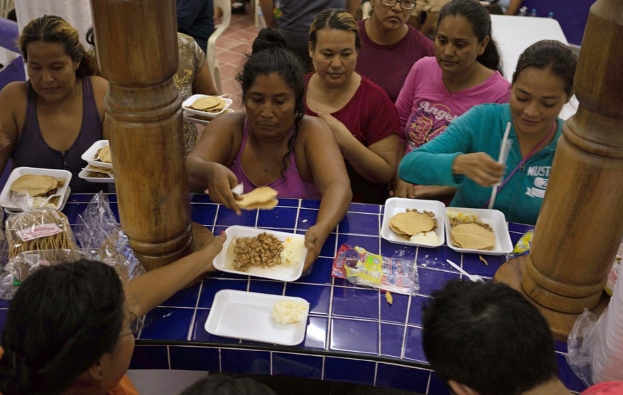 Oct. 23, 2015: Women, children and senior citizens get a meal at a shelter set up in preparation for the arrival of Hurricane Patricia in the Pacific resort city of Puerto Vallarta, Mexico.