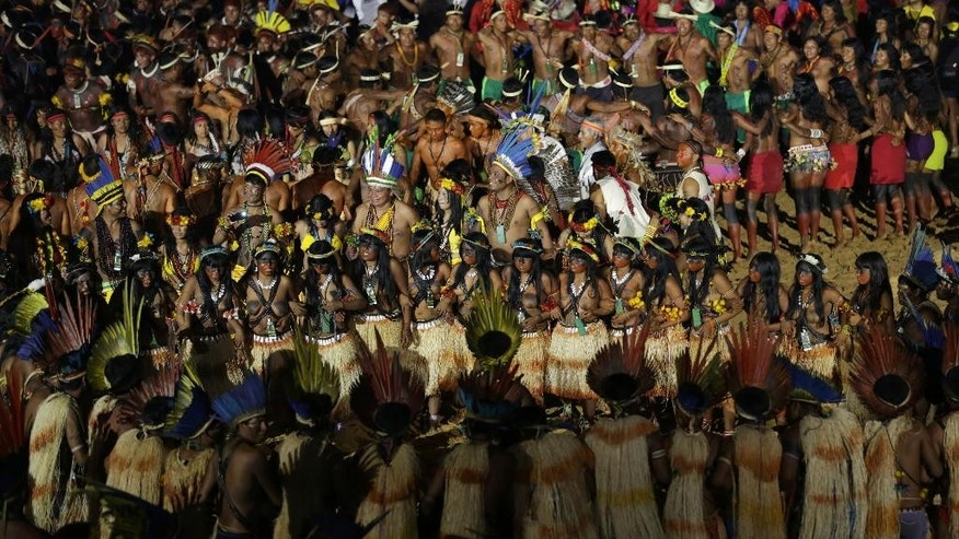 Indians from various ethnic groups and countries dance during the opening ceremony of the World Indigenous Games, in Palmas, Brazil, Friday, Oct. 23, 2015. Billed as the indigenous Olympics, the games are expected to attract athletes from dozens of Brazilian ethnicities, as well as from such nations as Ethiopia and New Zealand. (AP Photo/Eraldo Peres)