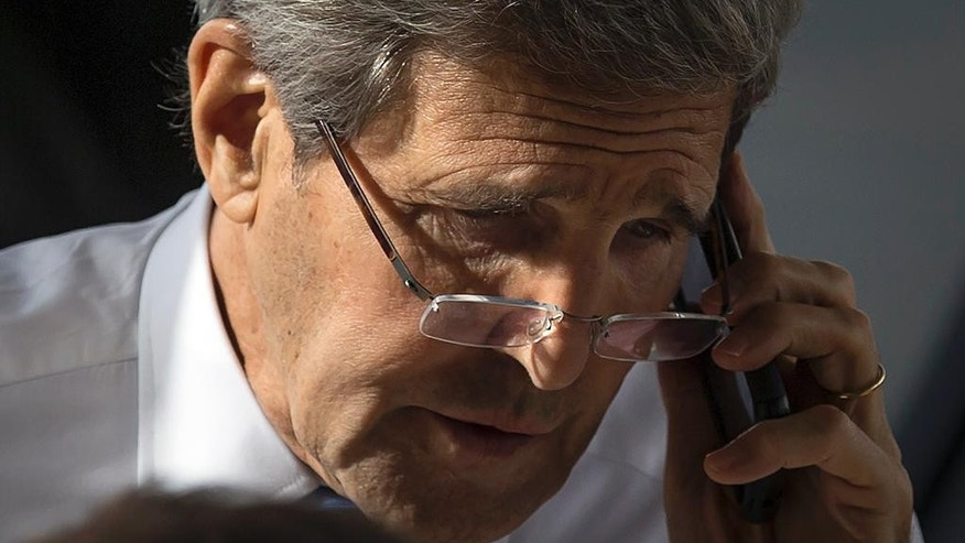 U.S. Secretary of State John Kerry talks on the phone while getting out of his motorcade as he arrives at Amman Civil Airport in Amman, Jordan, Saturday, Oct. 24, 2015.  Kerry is in Jordan renewing his push to ease violence and tension between Israel and the Palestinians. (Carlo Allegri/Pool Photo via AP)