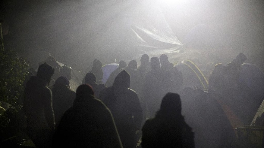 Migrants and refugees head to Serbia's border with Croatia, in Berkasovo, Serbia, Friday, Oct. 23, 2015. Most migrants fleeing war and poverty in the Middle East, Asia and Africa wish to go to Germany or other wealthier countries of Western Europe. (AP Photo/Marko Drobnjakovic)