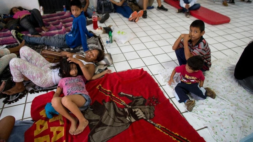 "Residents and tourists take refuge in a small shelter as they await the arrival of Hurricane Patricia in Puerto Vallarta, Mexico, Friday, Oct. 23, 2015. Residents and tourists were hunkering down or trying to make last-minute escapes ahead of what forecasters called a ""potentially catastrophic landfall"" later in the day. (AP Photo/Rebecca Blackwell)"