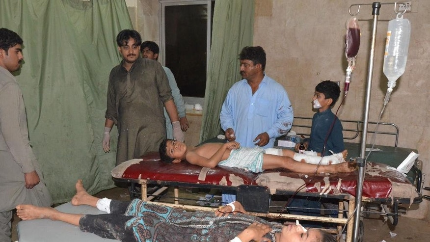 Pakistani children injured in a bomb attack being treated at a local hospital in Jacobabad, Pakistan, Friday, Oct. 23, 2015. A Pakistani police official says a suicide bomber has exploded himself in a Shiites mourners  procession in southwestern city,  killing several and injuring many others. (AP Photo/Amir Hussain)